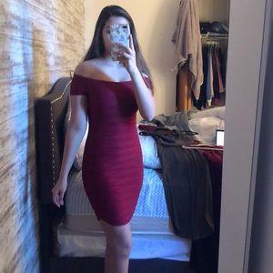 A maroon off the shoulder dress.